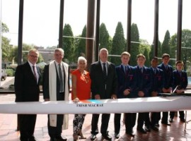Headmaster Ross Tarlinton, Director of Mission and College Chaplain Fr Gavin Foster, Trish Macrae, Ken Macrae and members of the Third IV who will race in the new boat.