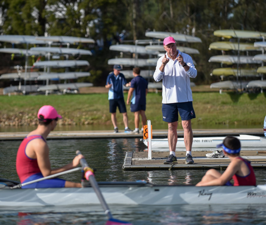 Rowing coach instructing boys