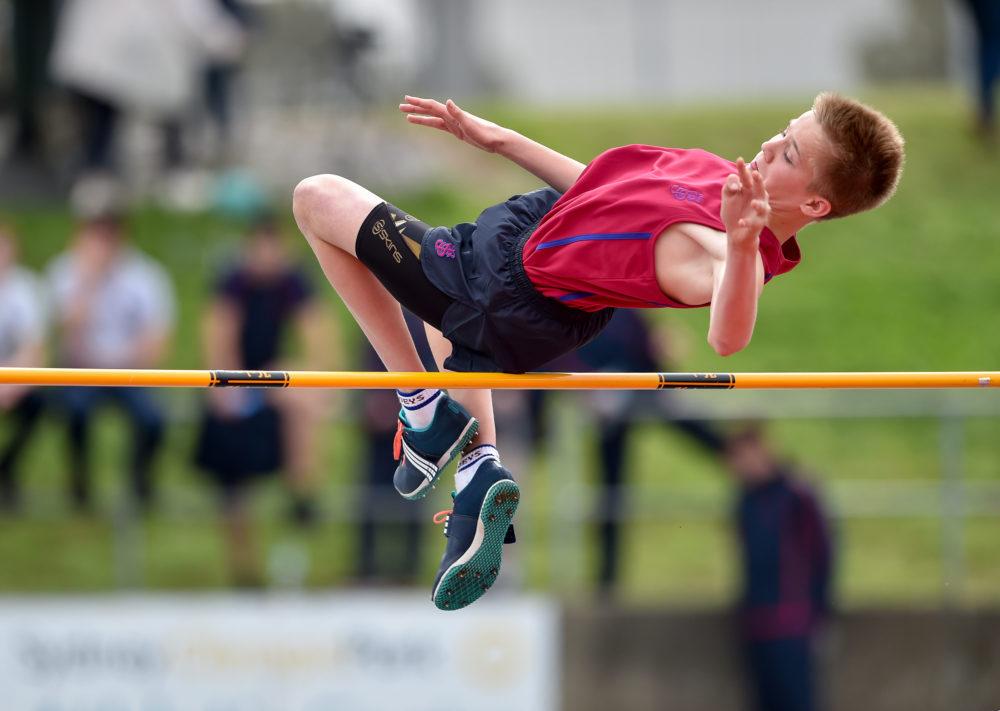 Joe Boy in mid-air high jump