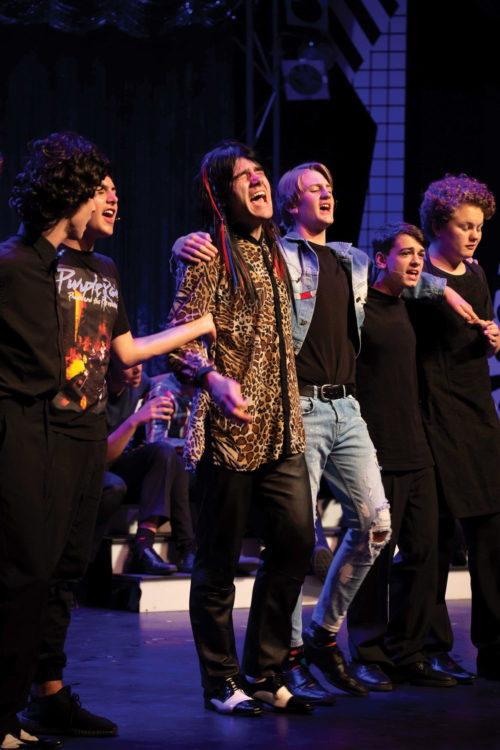 Joeys boys in stage at musical performance