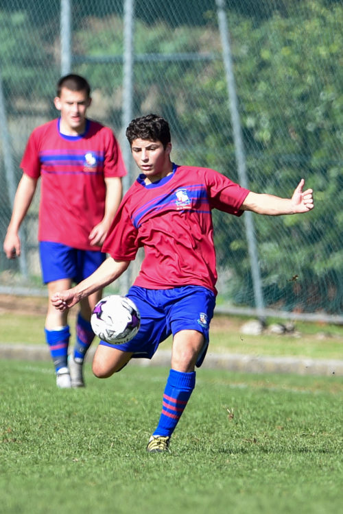 Joeys boy kicking soccer ball