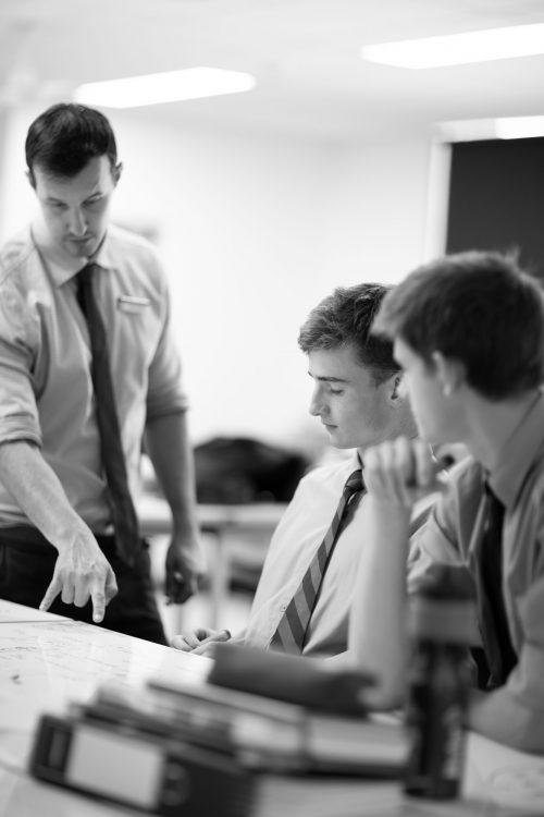 Joeys boys learning in classroom with teacher