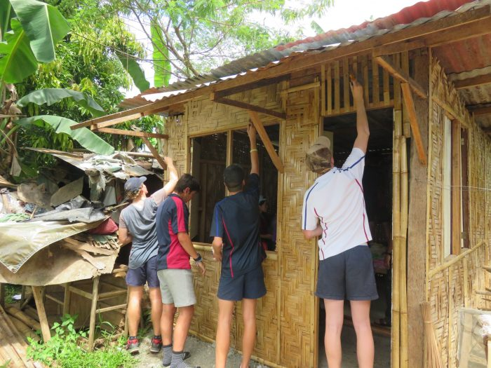Joeys boys repairing a house in the Philippines
