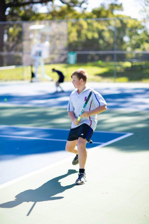 Joe boy playing tennis